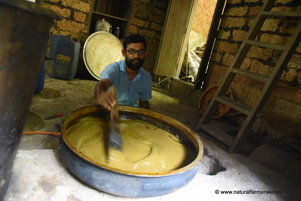 making medicine in traditional copper vessel